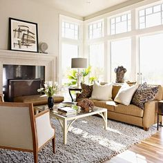 Exterior Focus-Exterior Focus  A neutral color palette is ideal when the view outside undressed windows is your focal point. A simple scheme of browns and soft grays suggested by natural wood and stone reads as an extension of the wetlands just outside the door of this eco-friendly living room. A few carefully edited accents and art pieces make the subdued interior worth an extended visit.