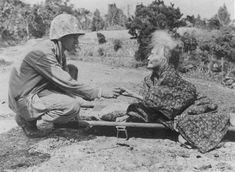 US Marine greeting a civilian woman Okinawa Japan 1945.