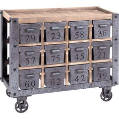 Wood and metal cart with twelve numbered drawers and factory-style wheels Product: CartConstruction Material: Wood an...