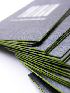 Our firm's business card designed and manufactured by The Fourth Wall . Two-sided letterpress printed with 2 different metallic silver inks onto grey/black thick board and finished with a hand painted striking light green edge - Photo by Ani Krikorian