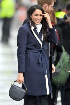 Meghan Markle makes her own fashion rules, and we love her for it. On her recent outing in Birmingham, England, the royal bride-to-be proved that navy and