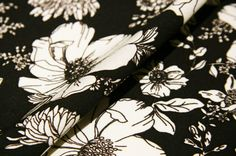This 100% rayon fabric has a beautiful large modern floral print overall. It has a nice weight, and would drape very nicely. Perfect for Tops, Costumes, Dancewear, Scarves, Shrugs, Cover-ups, Dresses, Skirts, Accent Pillows, Table & Window Coverings, etc.