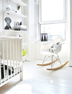 Post by Ollie Haus, black and white nursery, Eames rocker