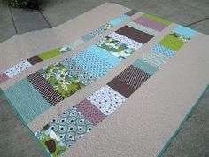 """12 + 2 = Q is a 90"""" x 96"""" queen bed quilt using 12 fat quarters and 2 bed sheets. Find the pattern here. ohfransson.com"""