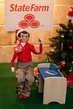 """Elf on the Shelf Ideas. """"It's Jake from StateFarm..."""" wearing his khakis and red shirt. To view more pins like this one, search for Pinterest user amywelsh18."""