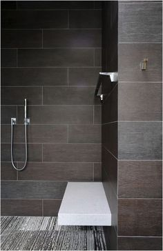 Dream Shower with built-in seat and combo towel rack that can also be a security rail