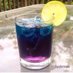 1 oz of Vodka oz of Blue Curacao Cranberry Juice Lime Garnish Pour in Vodka and Blue Curacao, then pour in Cranberry juice. Cranberry juice should sink to bottom and the Blue Curacao will float to the top, creating the purple bottom. Blue Drinks, Fancy Drinks, Vodka Drinks, Non Alcoholic Drinks, Summer Drinks, Cocktail Drinks, Mixed Drinks, Beverages, Vodka Martini