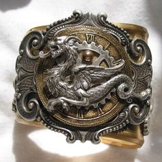 This is stunning. I would love to have it.  Steampunk Dragon Brass Cuff. $195.00, via Etsy.