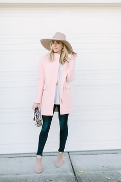 Dark denim jeans + pale pink coat, white top and hat