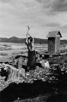 Tough desert woman chopping wood