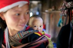 A woman of the Red Dao Ethnic Minority People of Vietnam carries baby on her back in Ta Van Village, Vietnam Stephen Bures,Ta Van Village, Vietnam November 2011 Read more: www. Mother And Father, Mothers, Family Love, Baby Wearing, Vietnam, Funny Pictures, Maternity, Parenting, American