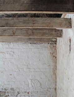 Exposed beams and rough walls.