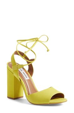 This vibrant, trendy sandal is set on a block heel and topped with thin, leg-lengthening wraparound laces. Too cute!