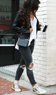 Possibly the easiest of all street style ensembles, we simply adore the combination of ripped skinny jeans, leather jacket and trainers.#winteroutfits #winter #outfits