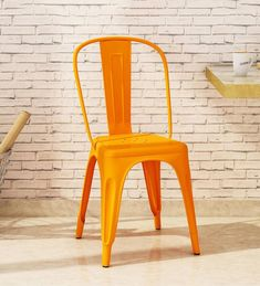 Buy Ekati Iconic Chair in Orange Colour with Eyelet by Bohemiana Online - Tolix Replica Chairs - Chairs - Furniture - Pepperfry Product Modern Dining Table, Rustic Table, Solid Wood Furniture, Funky Furniture, Orange Color, Colour, Chairs Online, Bedroom Paint Colors, Metal Chairs