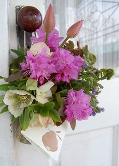 DIY May Day flowers in a jar, attached to the doorknob. Would also look good suspended from a wreath hangar, I think!