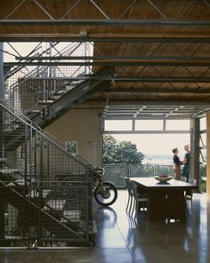 Industrial details...concrete floor, metalmrailings, garage door...edgey feel