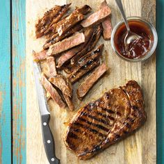 Grilled Marinated Ribeyes Recipe -These juicy steaks are a favorite meal of ours when we go camping. Let them sit in tangy, barbecue-inspired marinade overnight and you've got a rich and hearty dinner ready to grill up the next day. —Louise Graybiel, Toronto, Ontario