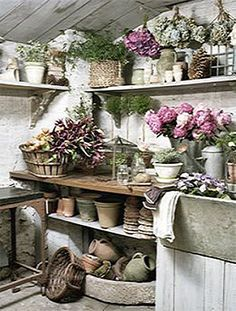 Potting Shed Interiors | Beautiful potting shed full of flowers, with an enviable stone sink