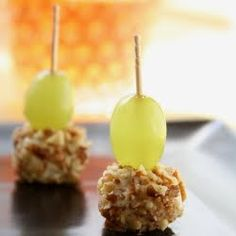 Drunken Grapes:  1 bunch seedless grapes (green, red, or globe)1 Package of Goat Cheese1/4 cup Pecans (toasted and chopped small)2 cups (or more) Bourbon*optional - dash of fresh grated nutmeg.  Soak grapes minimum 6 hrs.  Roll cheese into ball, then into pecans.  Chill then use toothpicks to stack them.