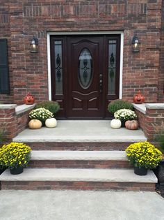 brick risers tie the steps into the house whilr concrete wall caps, treads, and paving ensure that the look is not overwhelming