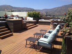 rooftop deck ideas wooden deck sunbeds comfortable seating area decorative pillows