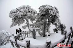 "Winter scenery at Mount Huangshan in east China's Anhui province. Mount Huangshan covers an area of 250 kilometers, of which 154 square kilometers are scenic attractions. Its landscape features ""four wonders"" of imposing peaks, spectacular rocks, odd-shaped pines, and a sea of clouds..."