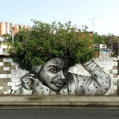 Street art and nature don't usually intersect, especially in large cities where most graffiti and tagging can be found. These gorgeous images are the exception — a beautiful melding of street art and urban flora. 3d Street Art, Amazing Street Art, Street Art Graffiti, Street Artists, Amazing Art, Graffiti Artists, Urbane Kunst, Foto Poster, Sidewalk Art