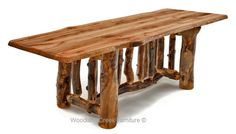 Rustic Log Dining Table with Reclaimed Live Edge Barn Wood Top. Available Custom Sizes by Woodland Creek Furniture.