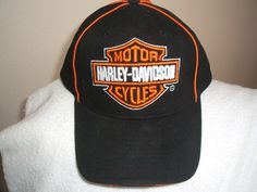 Harley-Davidson+motor+cycle/biker+embroidered+logo+on+new+black+ball+cap+w/tags:+Harley-Davidson+motor+cycle+embroidered+black+ball+cap+with+tags.++The+rear+has+adjustable+strap+with+H-D+embroidered+on+it+and+the+cap.++The+same+on+the+bill+of+the+cap.+One+of+a+kind