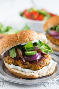 This chicken tandoori burger is packed full of spices and fresh chopped herbs. Piled high with fresh cilantro, cucumber, grilled onions and Greek yogurt sauce. This burger is perfect for all your summer BBQ parties!