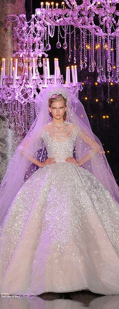 Elie Saab Couture Fall 2014♔PM - LOVE the dress but why would they have her look so angry. Not very bridal.