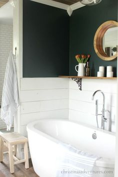 Half shiplap walls with deep green on top - love this oversized soaker tub and the wood shelf over the bathtub bathroom decor ship lap Vintage Inspired Farmhouse Bathroom Makeover - Christinas Adventures Bad Inspiration, Bathroom Inspiration, Half Walls, Ship Lap Walls, Small Bathroom, Bathroom Ideas, Bathroom Green, Bathroom Shelves, Master Bathroom