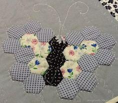 preciosa mariposa con hexagonos