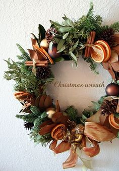 Christmas wreath, love the use of natural things, and rusty oranges!  So cozy!                                                                                                                                                                                 More