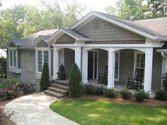 exterior. painted brick home. gray with cedar shake siding and white trim on windows