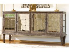 Crafted From Poplar Solids W/ Antiqued Mirror. Four Doors With One Adjustable Shelf Behind Each Pair.