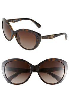 1dab8ae7e9a cat eyed sunglasses in brown by Prada Prada Sunglasses