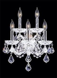 Maria Theresa Collection Wall Sconce From James Moder. Silver Finish Trimmed With French Pedalogues And Octagons Using Fine Machine And Handcut Polished Crystal - Warner Bros. Property Department