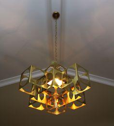 Custom fixture by Vanessa Bell. Unique light. Want one? omegalightingdesign.com