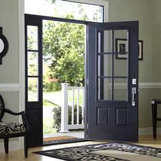 Front door with door casing, chair rail moulding and base board.