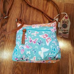 Wall Flower Bag Light blue and peach cotton bag with multicolored butterflies.    And a light brown strap. Wall Flower  Bags Shoulder Bags