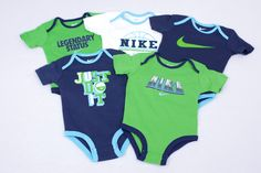 Nike onesies in blue and green