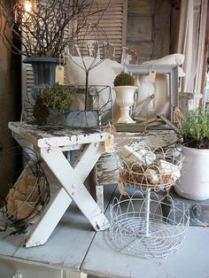 Love the different heights in the display and the mixture of textures and materials. Chippy wood & Country Roads...