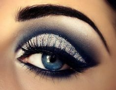 Silver/dark eye makeup.