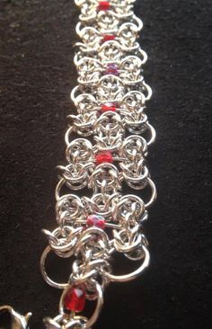 Chain maille bracelet with red jewels by LABweorc on Etsy, $25.00