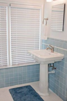 rue magazine: pretty bathroom with aqua blue tiled half walls and