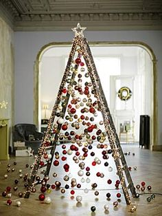 Ladder Christmas Tree is very fun and you can decorate it with your imagination. Although lots people love a traditional tree,they may also like Ladder Christmas Tree. You can save … Ladder Christmas Tree, Unusual Christmas Trees, Alternative Christmas Tree, Creative Christmas Trees, Christmas Tree Ideas For Small Spaces, Unique Christmas Ornaments, Christmas Windows, Xmas Trees, Christmas Lights