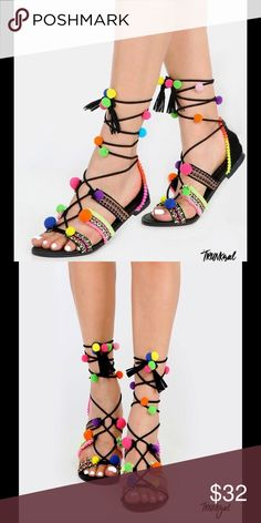 POSH BLACK POM POM LACE-UP SANDALS Get your bohemian rhapsody on in the Posh Black Pom Pom Lace-Up Sandals! These embroidered sandals are one of a kind that features an open toe with embroidered straps, lace up design, tassel accents, and vibrant neon pom poms. Trunkgal Shoes Sandals