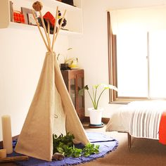 I like this idea for Violet's room when she is older. I've seen little teepees like this for sale on Lime Tree kids!
